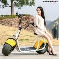 original-scrooser-gelb-mit-frau-elektroscooter-beim-experten-fuer-elektromobilitaet-im-funshop-wien-kaufen-testen-probefahren-und-kaufen