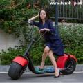 original-scrooser-rot-mit-einer-frau-elektroscooter-beim-experten-fuer-elektromobilitaet-im-funshop-wien-kaufen-testen-probefahren-und-kaufen